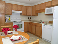 Apartments feature fully appointed kitchens and personal laundry facilities  providing every convenience of a traditional home.